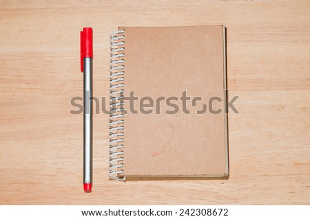 Daily and pen on the table - stock photo