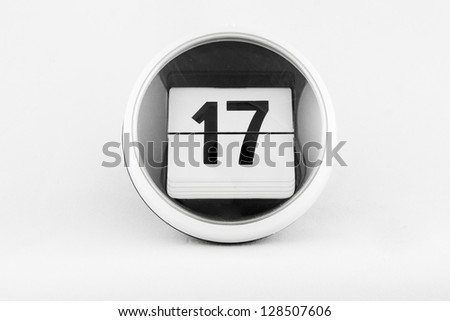 Daily calendar date change on a white background. day 17 - stock photo