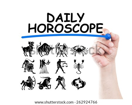 Daily horoscope with zodiac signs concept made on transparent wipe board with a hand holding a marker - stock photo