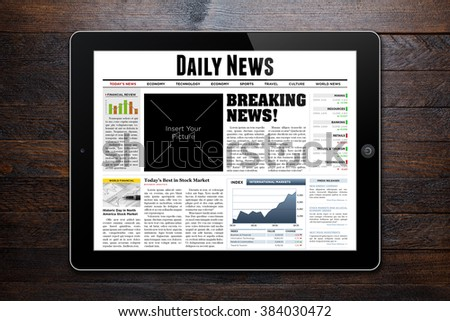 Daily News displayed on tablet on wooden background. - stock photo