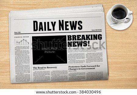 Daily Newspaper with a cup of coffee. - stock photo