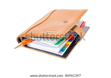 Daily planner and orange pen - stock photo