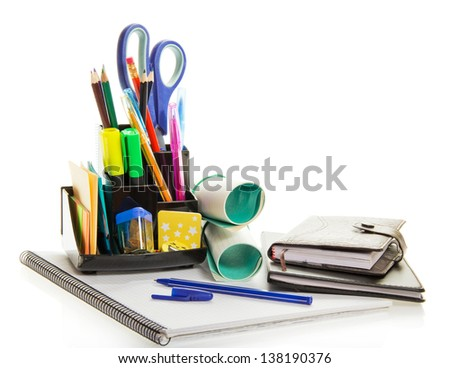Daily planner, exercise book, office supply, and ballpoint, isolated on white - stock photo