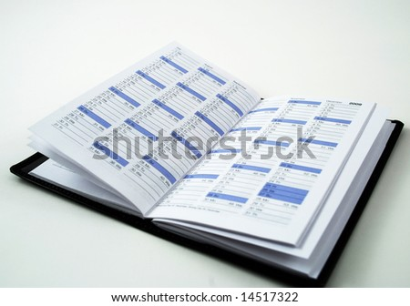 daily planner used to keep appointments and reminders - stock photo