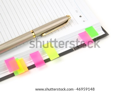 Daily planner with colored bookmarks. White background.