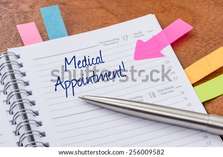 Daily planner with the entry Medical appointment - stock photo
