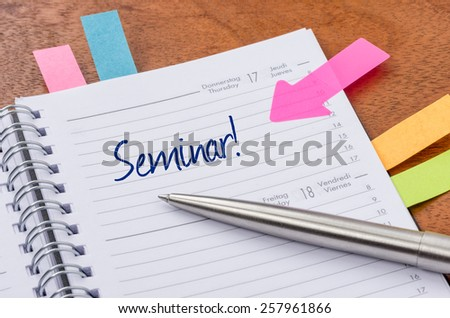 Daily planner with the entry Seminar - stock photo