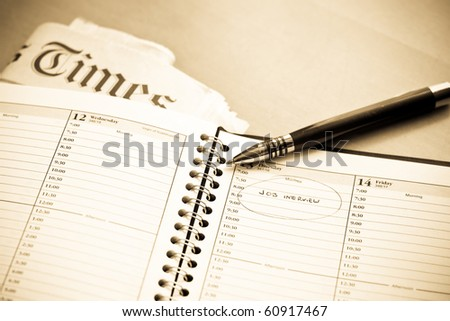 Daily Task Organizer with Job Interview Log - stock photo