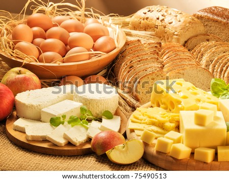 Dairy food, eggs, breads and apples 2 - stock photo