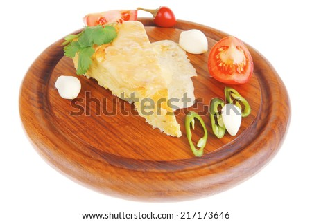 dairy food : vegetable cheese casserole slice on wooden plate served prepared with tomatoes  and garlic isolated over white background - stock photo