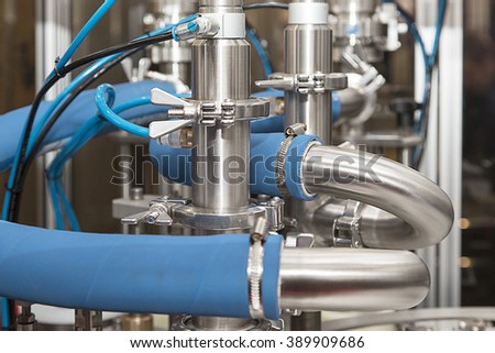 Dairy production. Apparatus for bottling milk products - stock photo