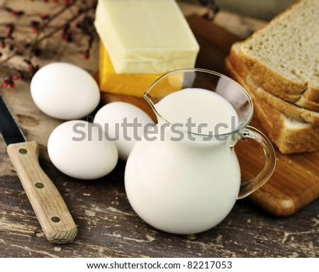 dairy products and Fresh eggs on a old wooden table - stock photo