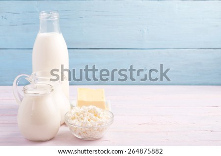 Dairy products at left side light blue background - stock photo