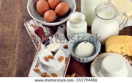 Dairy products on a rustic wooden table. View from above