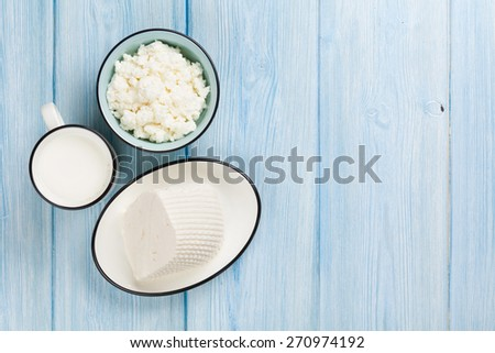 Dairy products on wooden table. Milk, cheese and curd cheese. Top view with copy space - stock photo