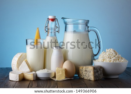Dairy products on wooden table still life - stock photo