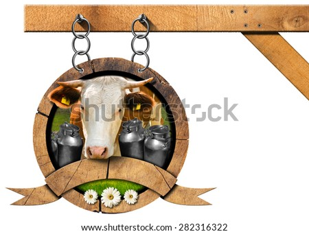 Dairy Products - Sign with Chain. Dairy products sign with head of cow, cans for the transport of milk, green grass and three daisy flowers. Hanging from a metal chain on a pole and isolated on white - stock photo