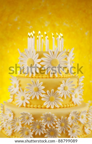 Daisy birthday cake with candles - stock photo