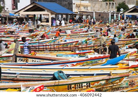 Dakar, Senegal - September 05, 2012: The Soumbedioune fish market in Dakar with the typical colourful fish-boat