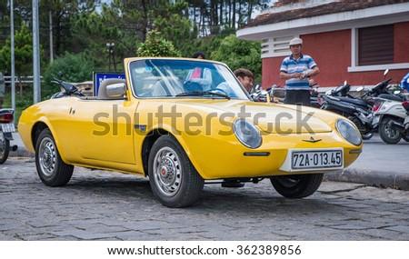 Dalad, Vietnam - Jan 9, 2016 : Yellow 1969 FIAT 850 spider sport vintage car parking at Dalad Train station,Dalad ,Vietnam. - stock photo