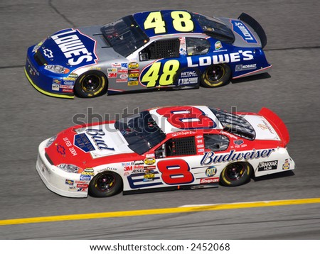 Dale Jr and Jimmie Johnson side be side - stock photo