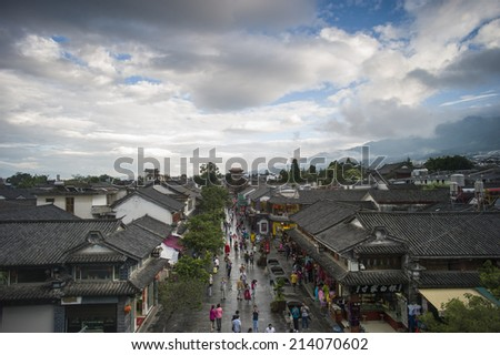 DALI, CHINA - MAY14 : Old buildings and streets located in Dali Old City, Yunnan, China on May 14 2014. Dali is now a major tourist destination for domestic and international tourists. - stock photo