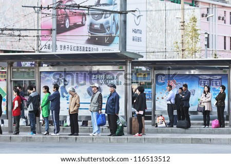 DALIAN-CHINA-OCT. 14, 2012. Station with advertising on Oct 14, 2012 in Dalian. China has 50,000 outdoor advertising companies. This advertising became third largest medium after TV and print media. - stock photo