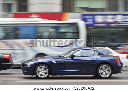 DALIAN-NOV. 25: BMW Z sports car on the road. BMW sales in China soared by 36.8% to 80,014, ahead of the US which rose 16.6% to 75,729 and Germany which increased 2% to 66,222. Dalian, Nov. 25, 2012. - stock photo