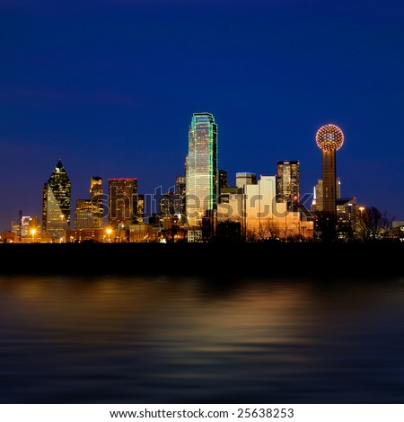 Dallas city skyline at night shot over the Trinity river - stock photo