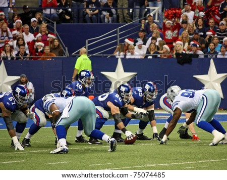 DALLAS - DEC 14:  NY Giants quarterback Eli Manning calls signals and prepares to receive the snap from center in a game with the Dallas Cowboys. Taken in Texas Stadium on Sunday, December 14, 2008. - stock photo