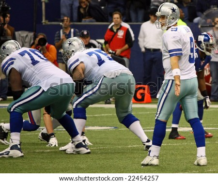 DALLAS - DEC 14:  Sunday, December 14, 2008. Dallas Cowboys Quarterback Tony Romo waits for the snap from the center. Taken in Texas Stadium. - stock photo
