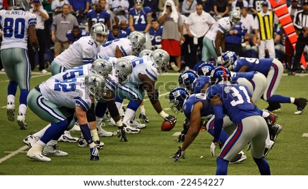 DALLAS - DEC 14: Sunday, December 14, 2008. Tony Romo and the Dallas Cowboys lineup against the NY Giants. Taken in Texas Stadium. - stock photo