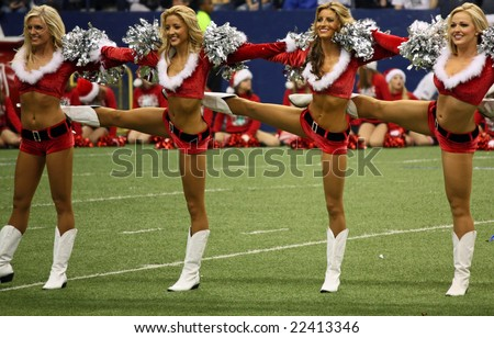 DALLAS - DEC 14: Taken in Texas Stadium on Sunday, December 14, 2008. Dallas Cowboys cheerleaders during a Christmas theme halftime. Cowboys played the NY Giants. - stock photo