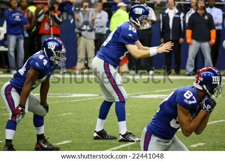 DALLAS - DEC 14: Taken in Texas Stadium on Sunday, December 14, 2008. NY Giants Quarterback Eli Manning prepares to receive the snap from center during a game with the Dallas Cowboys.