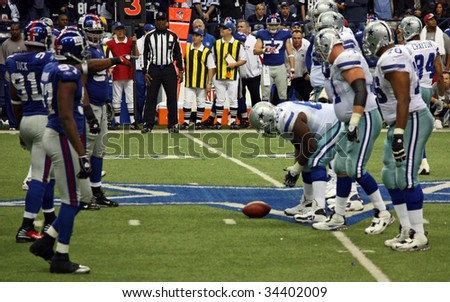 DALLAS - DEC 14: Taken in Texas Stadium on Sunday, December 14, 2008. The Dallas Cowboys offense lines up against the NY Giants defense in an NFL game. - stock photo