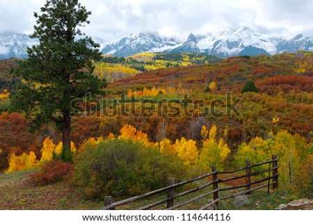 Dallas Divide Colorado with fence at Sneffels Mountain Range - stock photo