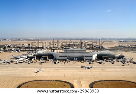 DALLAS FT WORTH - FEB 26: The Dallas Fort Worth airport is shown on Feb. 26, 2009 in Texas. The airport plans millions of dollars worth of incentives for new international routes. - stock photo