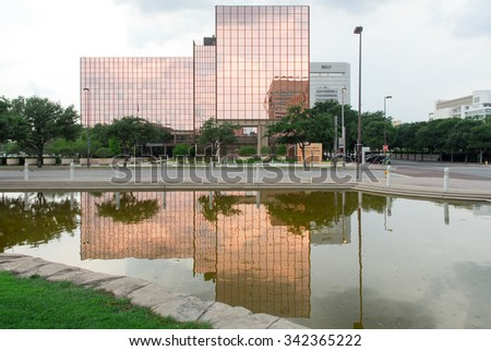Dallas - May 13, 2015: A. Maceo Smith Federal Building in Dallas, Texas reflected across from Pioneer Square.