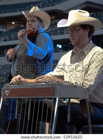 DALLAS - MAY 17.  Eleven Hundred Springs, with Jordan Hendrix on the Fiddle and Burton Lee on the steel guitar, plays country music at the Cowboys Stadium on May 17, 2010 at Dallas, Texas.