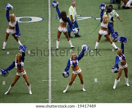 DALLAS - OCT 5: Texas Stadium in Irving, Texas on Sunday, October 5, 2008. Dallas Cowboys cheerleaders perform. The last season Dallas will play in Texas Stadium. - stock photo