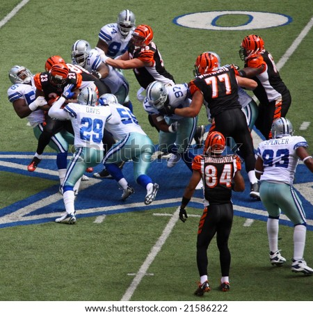 DALLAS - OCT 5: Texas Stadium on Sunday, October 5, 2008. The Dallas Cowboys defense tackles the Cincinnati Bengals runner. The last season that they will play in this stadium. - stock photo