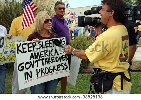 DALLAS -  SEPTEMBER 4: A crowd of over 2,000 gathered for the Tea Party Express in Dallas, Texas on Sept. 4, 2009 to voice concern over big government spending and the healthcare proposal.