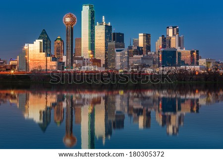 Dallas skyline reflected in Trinity River at sunset - stock photo