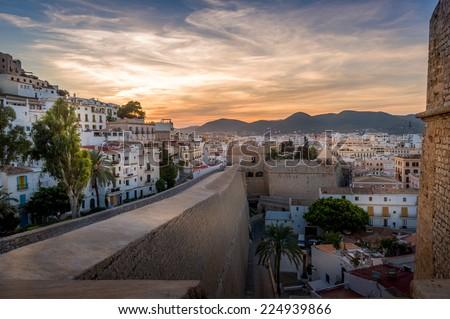 Dalt Vila and Almudaina castle in Ibiza old town. Vivid sunset scene. - stock photo