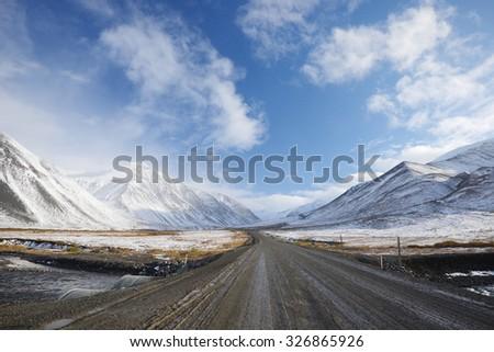 dalton highway in alaska at north slope - stock photo
