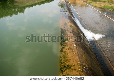 Dam for water in the lake supply for summer - stock photo