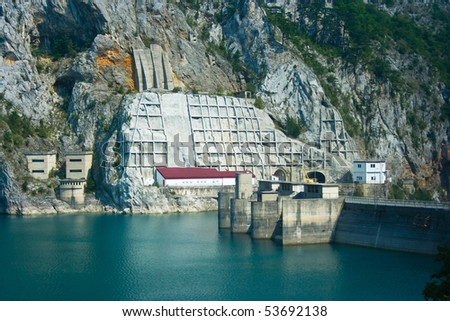 Dam on the river and the plant - stock photo