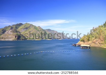 dam with raft and buoyancy on clear sky, use polarizing filter