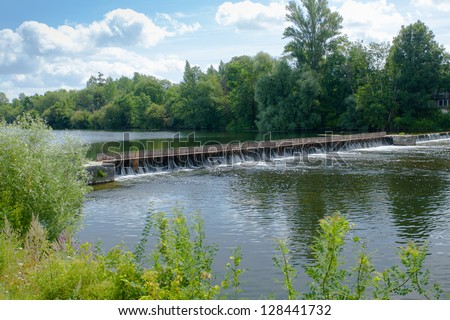 dam with wooden needles in France - stock photo