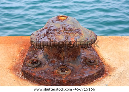 Damage bollard by corrosion defect - stock photo